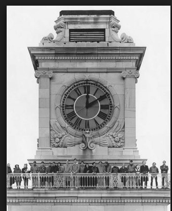 Tourists  and artists enjoy the view from the Clocktower Gallery, date unknown.