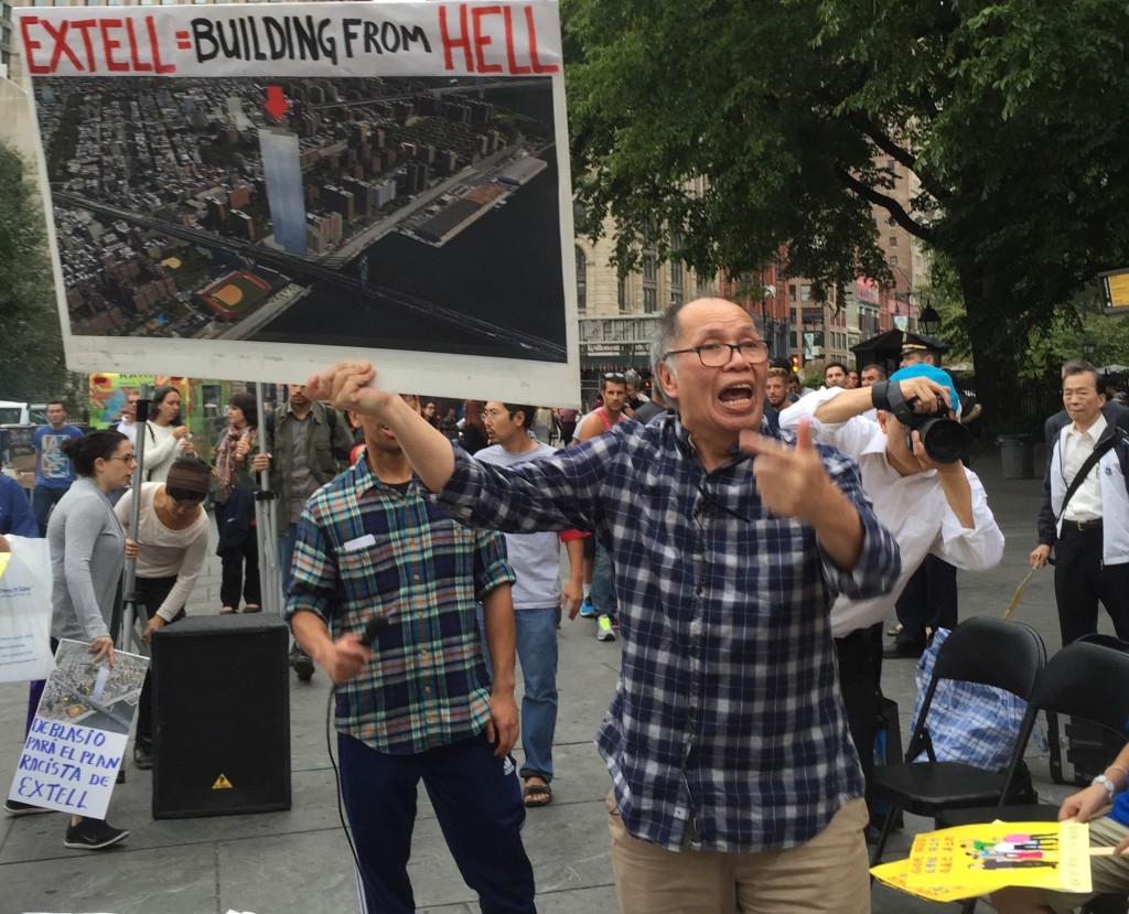 """The """"building from hell"""" at a rally at City Hall"""